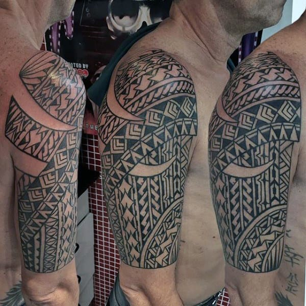Awesome Male Half Sleeve Tribal Tattoo
