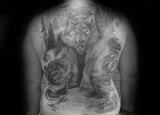 Awesome Male Shaded Black And Grey Ink Wolf Back Tattoo