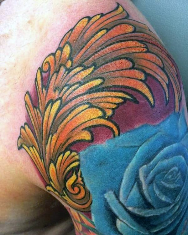 Awesome Mens Orange Filigree Tattoo With Blue Rose Flower On Upper Arm And Shoulder
