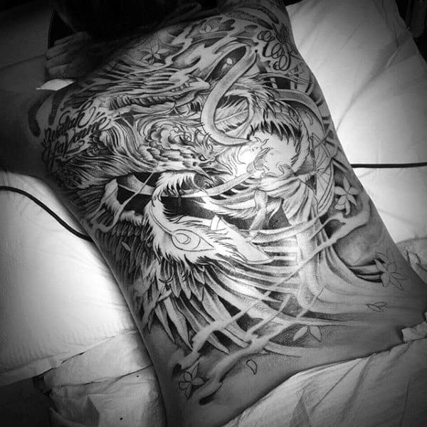 Awesome Phoenix Back Tattoo On Male