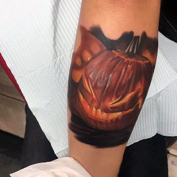 Awesome Realistic Jack O Latern Pumpkin Tattoos For Men