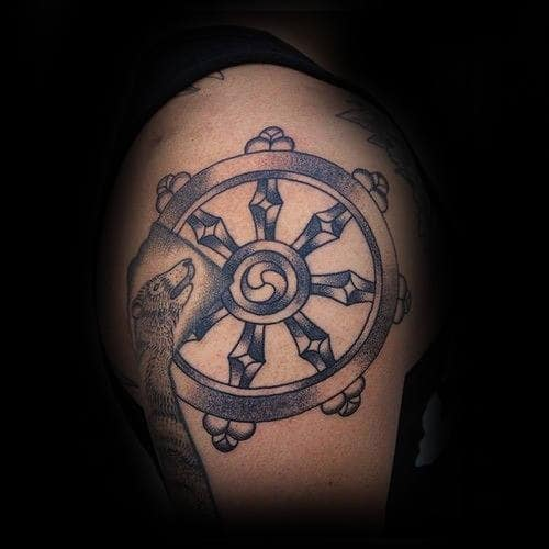 Awesome Shaded Dharma Wheel Upper Arm Tattoo For Guys