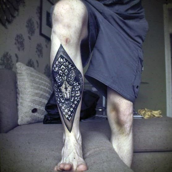 Awesome Shin Tattoo Of Geometric Deer Skull On Man