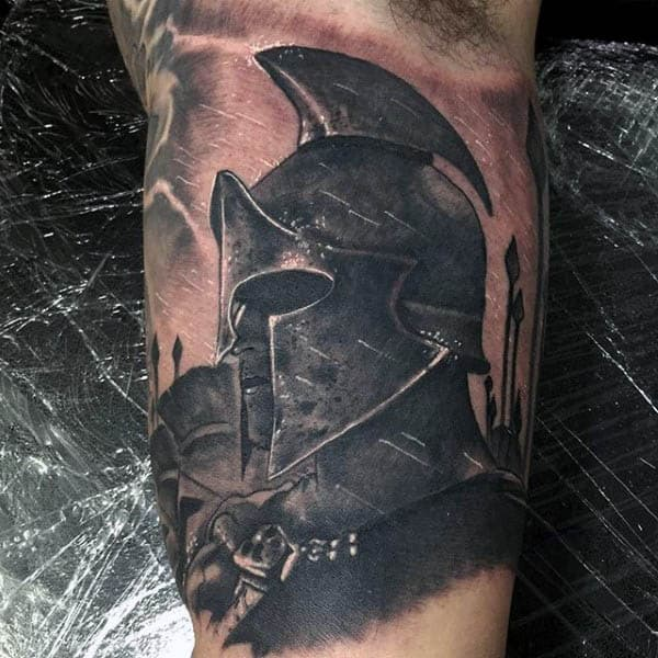 Awesome Spartan Male Spear Tattoo On Inner Arm