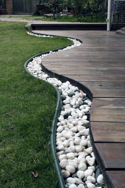 Awesome Stone Edging Ideas White River Rock Border Of Wood Deck