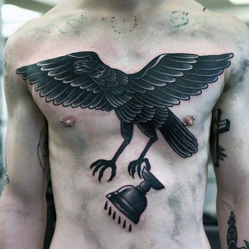 Awesome Traditional Crow Flying With Cup Mens Chest Tattoo