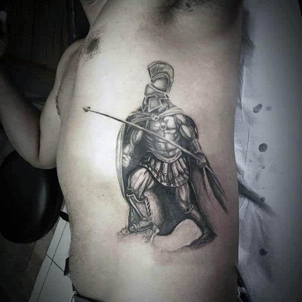 Awesome Warrior With Spear Tattoo On Males Rib Cage Side