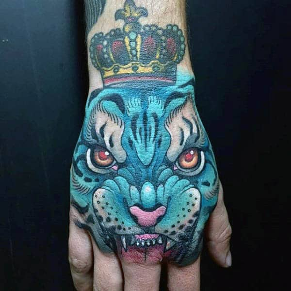 Azure Blue Crowned Beast Tattoo On Male Hands
