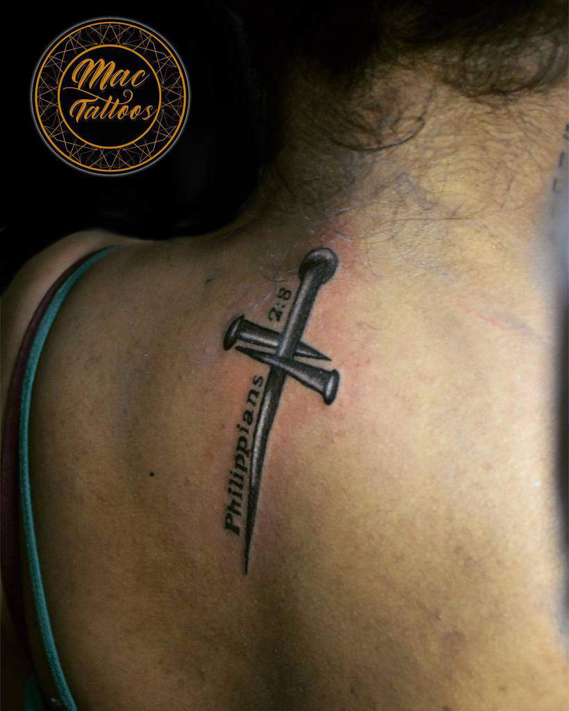 back cross tattoos for women mac_tattoos_