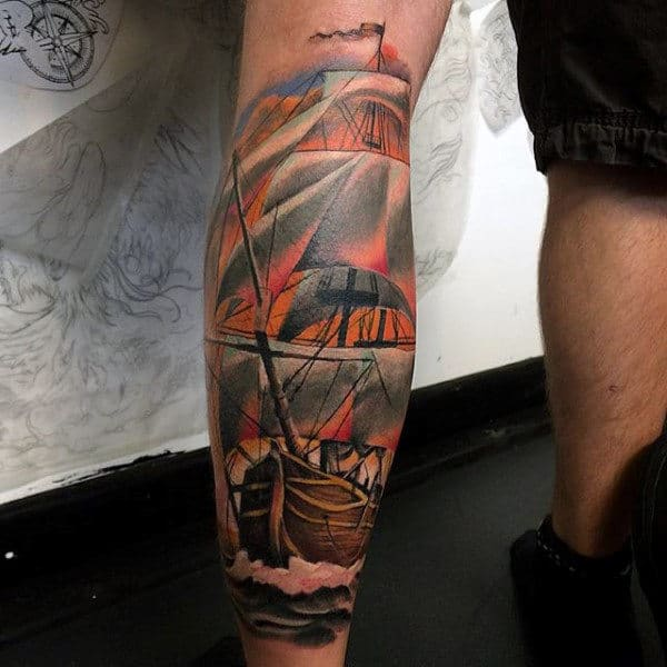 Back Of Legs Ship Wheel And Anchor Tattoo On Man