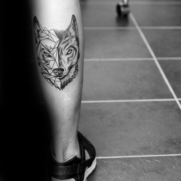 Back Of Leg Calf Man With Tattoo Of Geometric Wolf