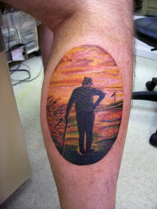 Back Of Leg Calf Tattoos Of Beautiful Oval Stamp Contemplating Golfer For Guys