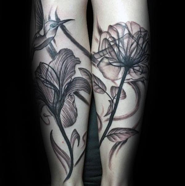 Back Of Legs Guys Hummingbird With Flowers Tattoo