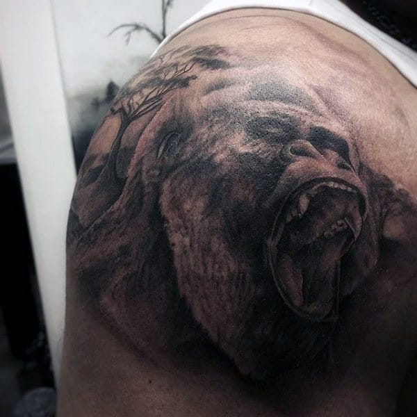 Back Of Shoulder Gorilla With Tree Tattoo On Back Of Mans Shoulder