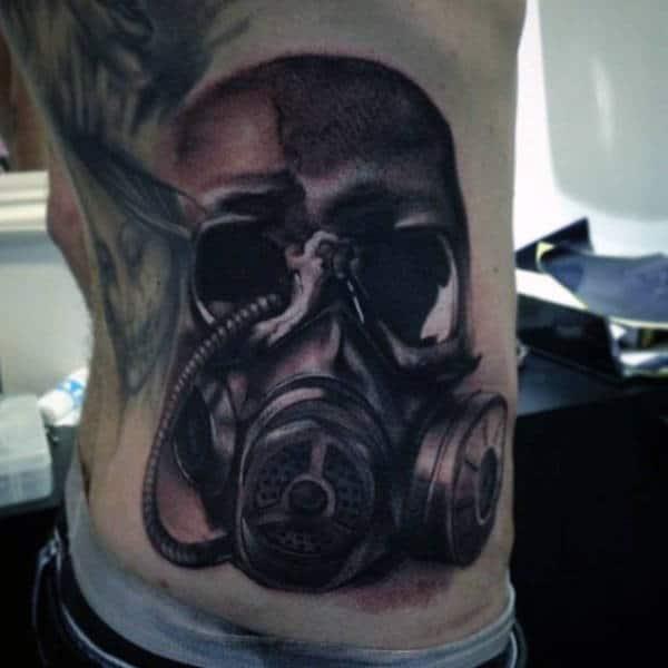 Back Side Rib Cage Gas Mask Tattoo On Man