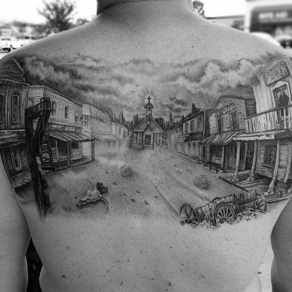 Back Tattoo Scene Of Western Town Abandoned In Black And White On Man