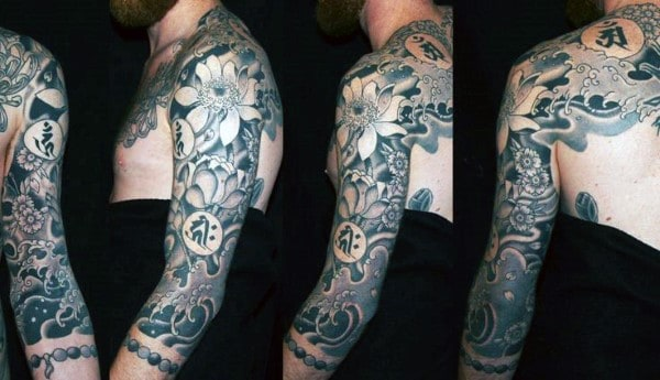 Back With Sleeve Tattoo Of Lotus Flower On Male