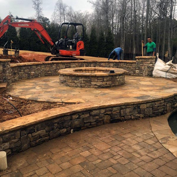 Backyard Flagstone Patio Design Ideas With Built In Round Fire Pit