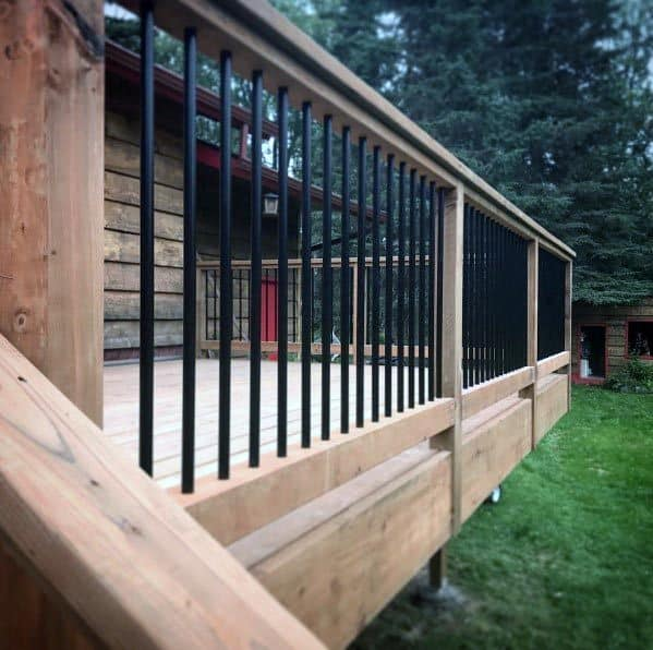 Backyard Ideas Wood Deck Railing With Black Round Metal Balusters