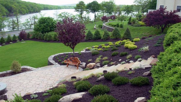 Backyard Stone Patio Slope Landscaping Ideas