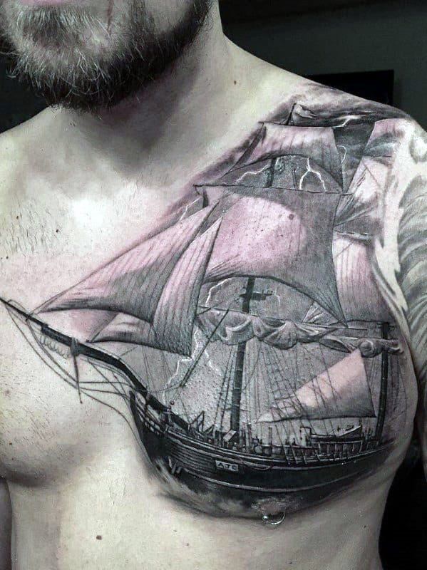 Badass Tattoo Of Shaded Sailing Ship On Mens Upper Chest And Shoulder