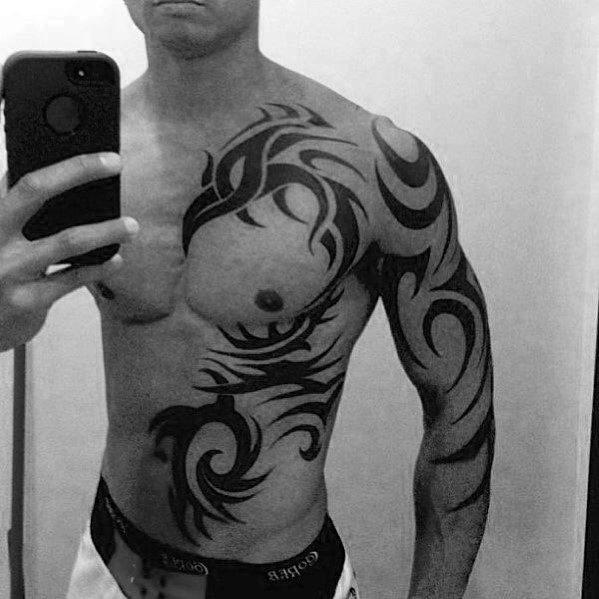 Badass Tribal Phoenix Chest Tattoo Ideas On Guys