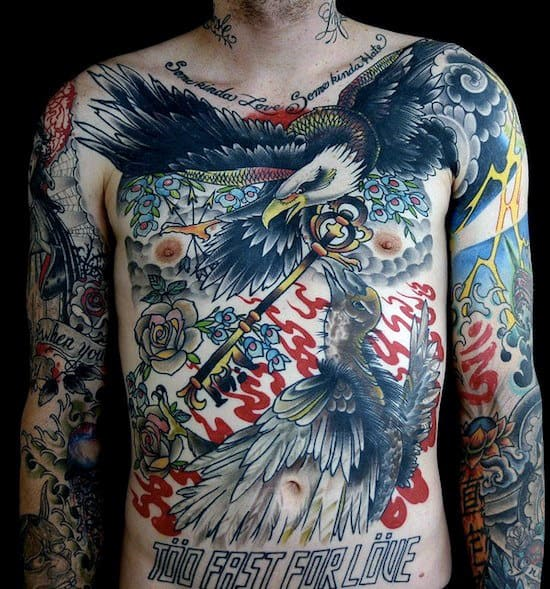 Bald Eagle Flying With Key Mens Chest Tattoos