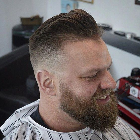Bald Fade Haircut With Long Beard