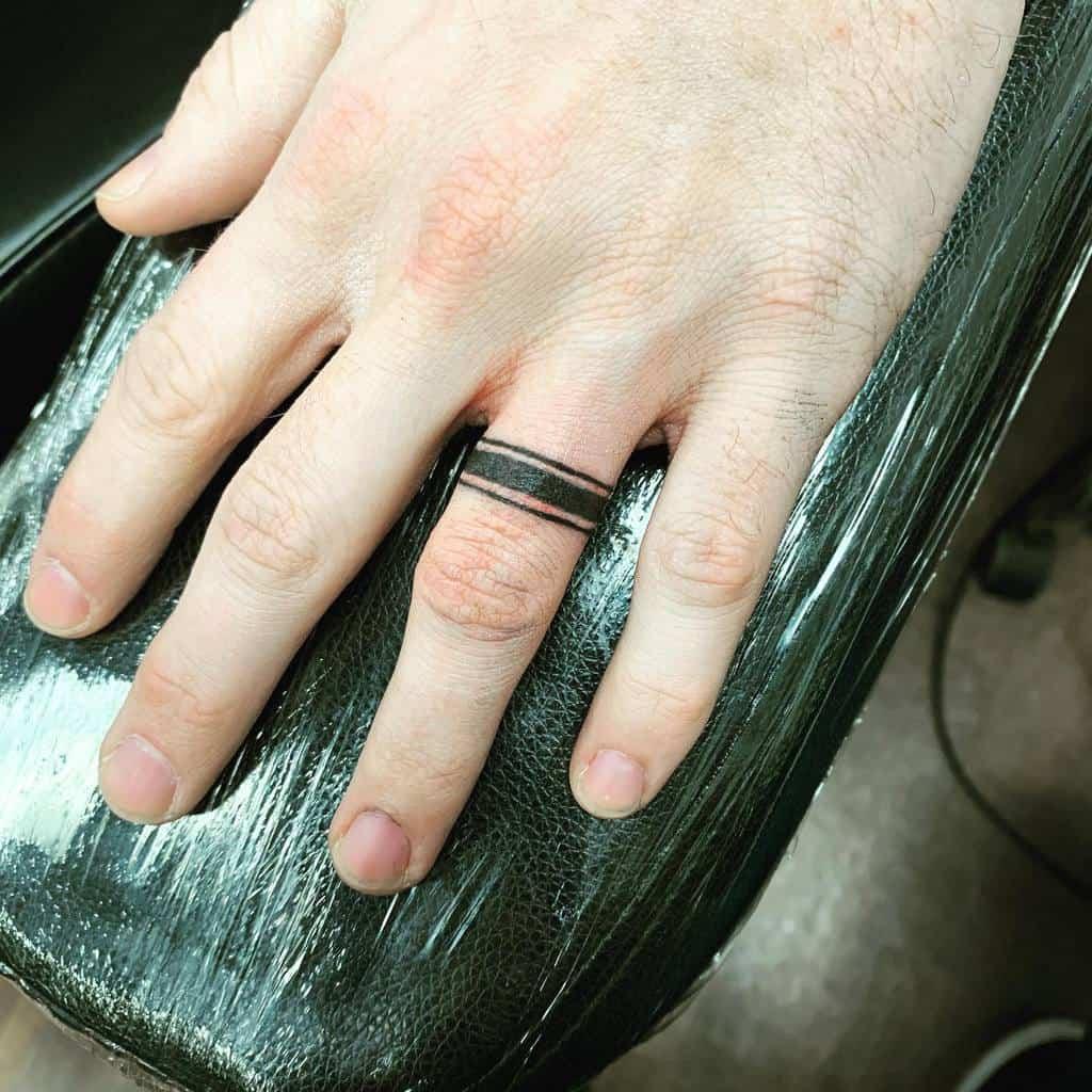 Band Wedding Ring Tattoo Reggietherascal13