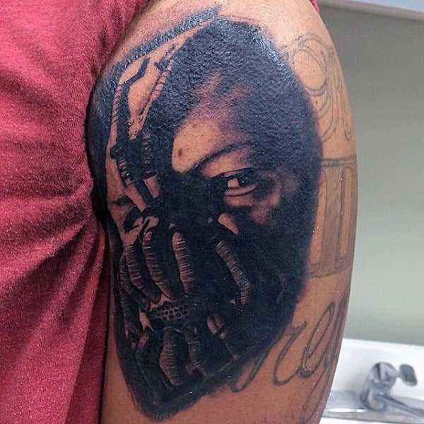 Bane Batman Upper Arm Black Ink Shaded Tattoo Design Ideas