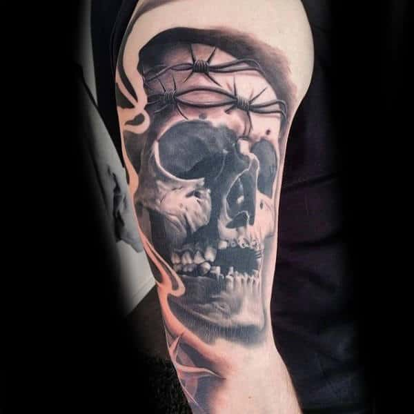 Barbed Wire Bicep Tattoo On Man With Skull Shaded Black Ink Design