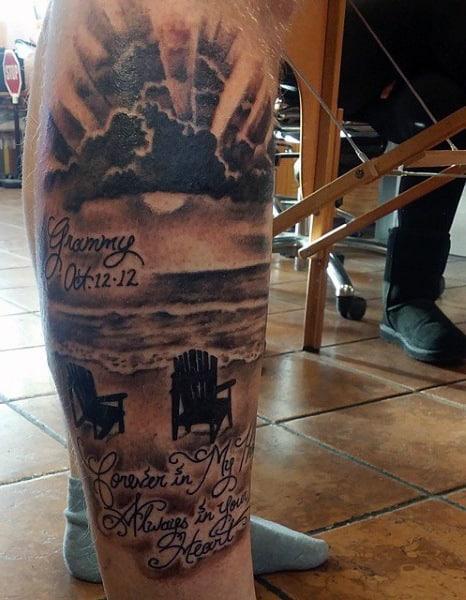 Beach Themed Tattoo For Men On Lower Leg