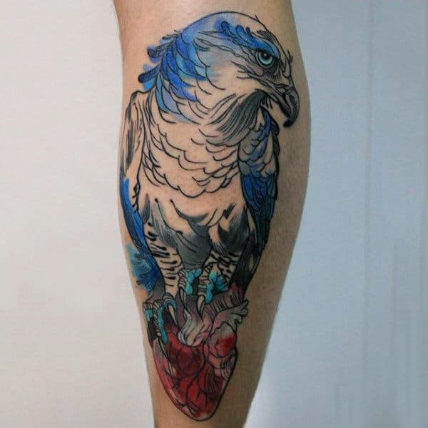 Beautiful Blue Ink Hawk Clutches Heart Tattoo For Gentlemen