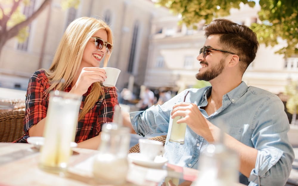 beautiful loving couple sitting in cafe