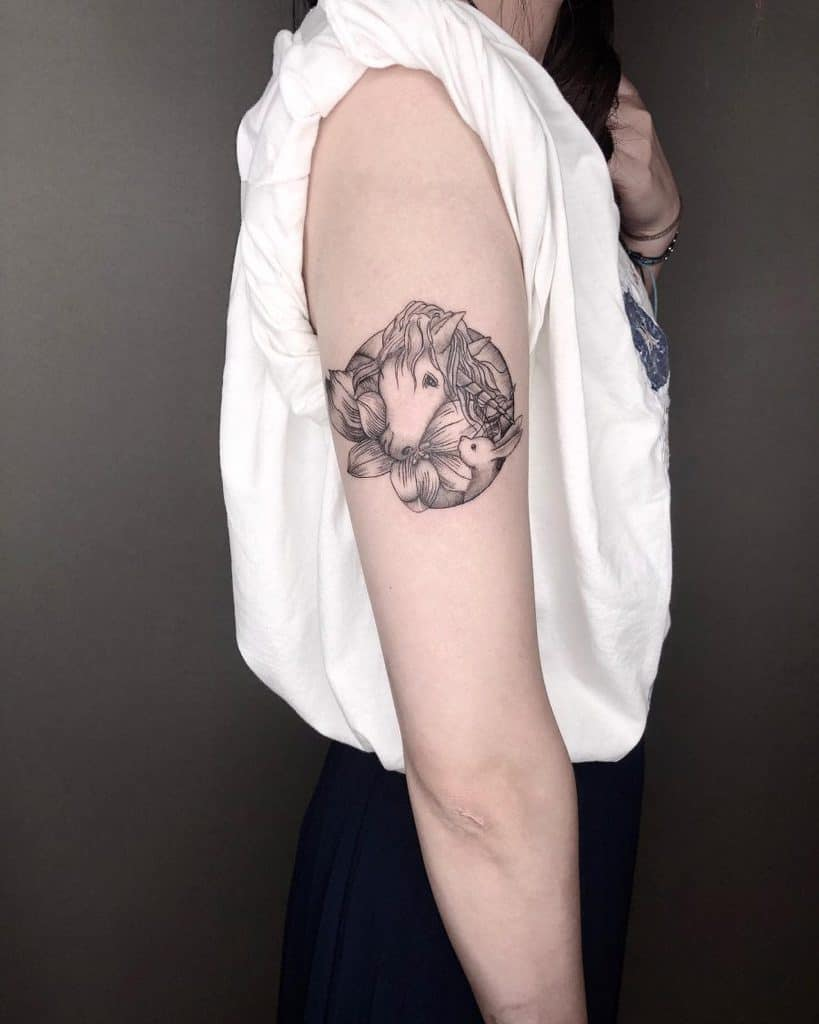 Beautiful Mid Bicep Head With Hibiscus Linework Unicorn Tattoo