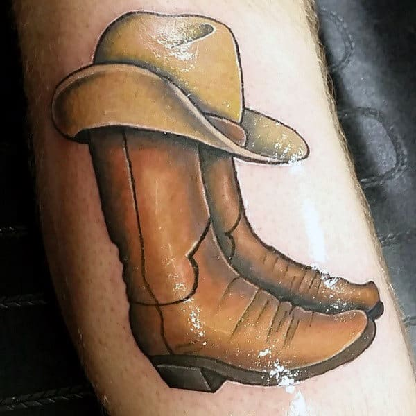 Beautiful Shaded Illustrative Realistic Tattoo For Guys With Cowboy Boots And Hat