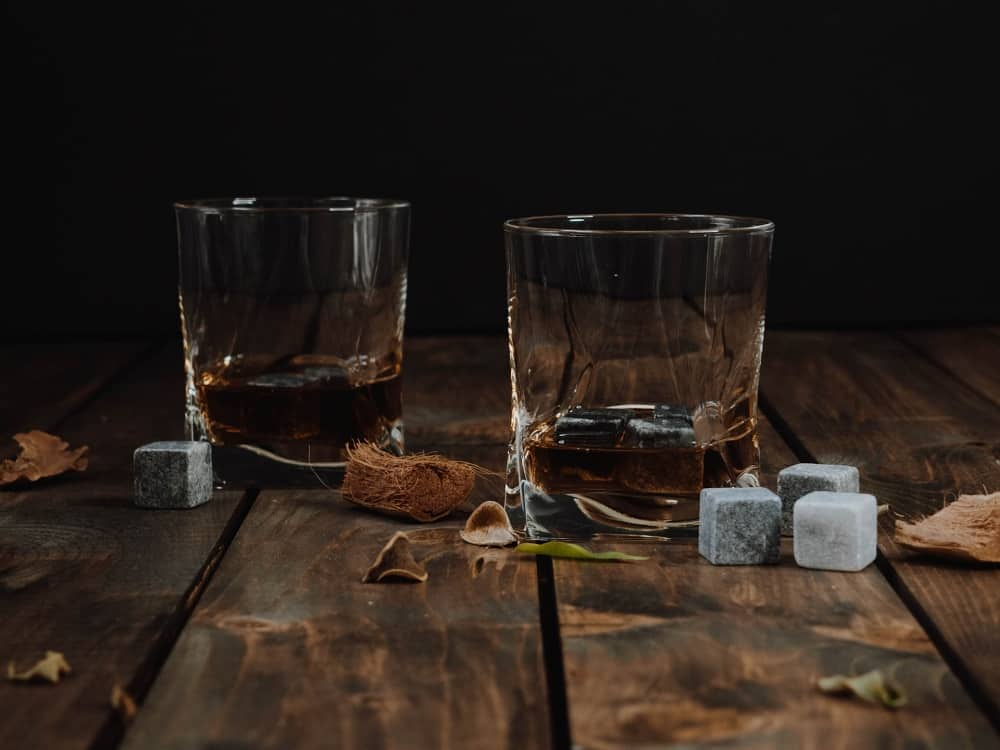 beer drinking glasses on wooden table