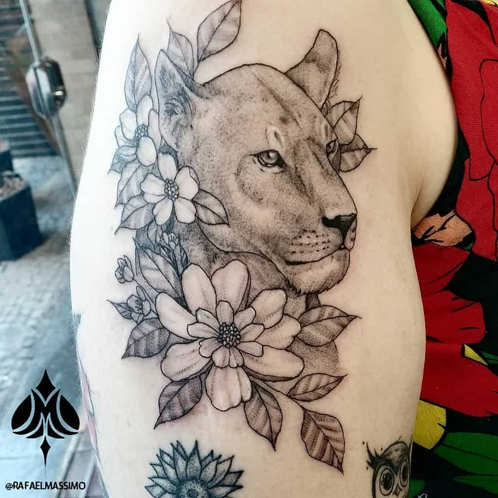 Best Black Work Lion Tattoo