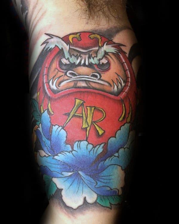 Bicep Inenr Arm Daruma Doll Tattoos For Mens