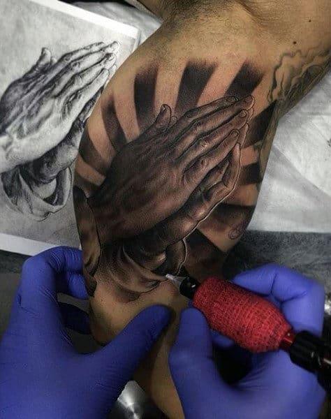 Bicep Praying Hands Tattoo Ideas For Men