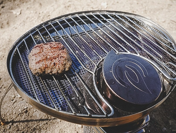 Biolite Campstove 2 Review Cooking Sausage Patty On Grilltop Outdoors