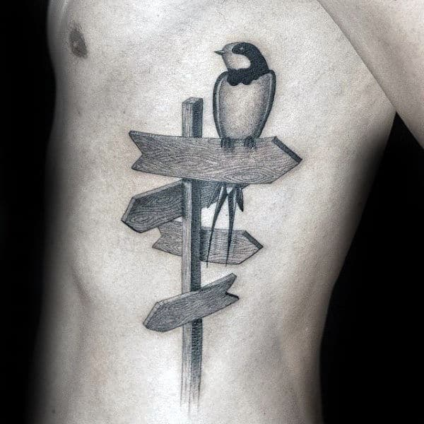Bird On Sign Unique Mens Ribs Tattoo Ideas