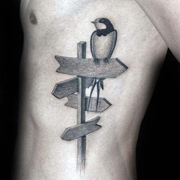 Bird On Sign Unique Mens Ribs Tattoo Ideas