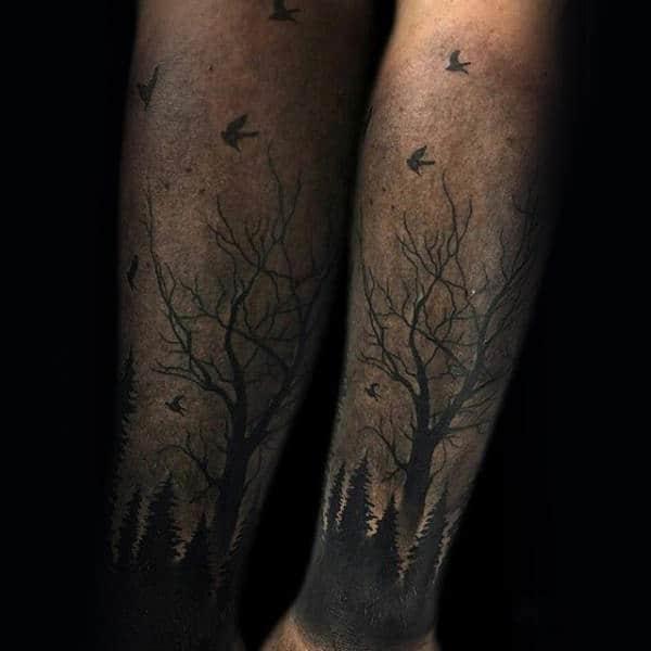 Birds Flying Over Trees Mens Forearm Tattoo