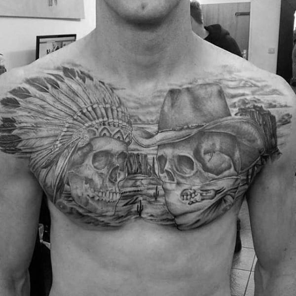 Black And Grey Chest Pieces Tattoo On Man With Cowboy And Indian Skull