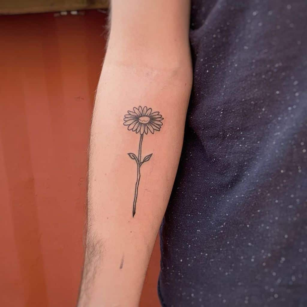 Forearm tattoo black and grey daisy