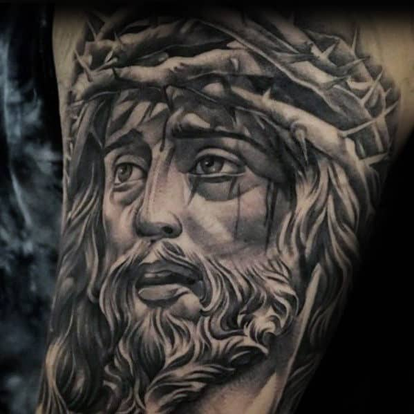 Black And Grey Heavily Shaded Jesus With Crown Of Thorns Male Arm Tattoos