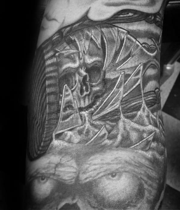 Black And Grey Ink Broken Hourglass Skull Mens Arm Tattoos