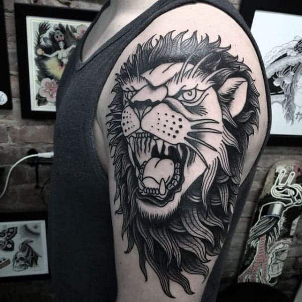 black-and-grey-ink-male-traditional-arm-lion-tattoos