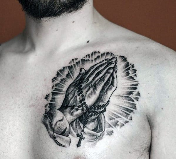 Black And Grey Ink Small Praying Hands With Rosary Chest Tattoos For Men